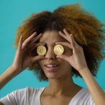 Woman with bitcoins