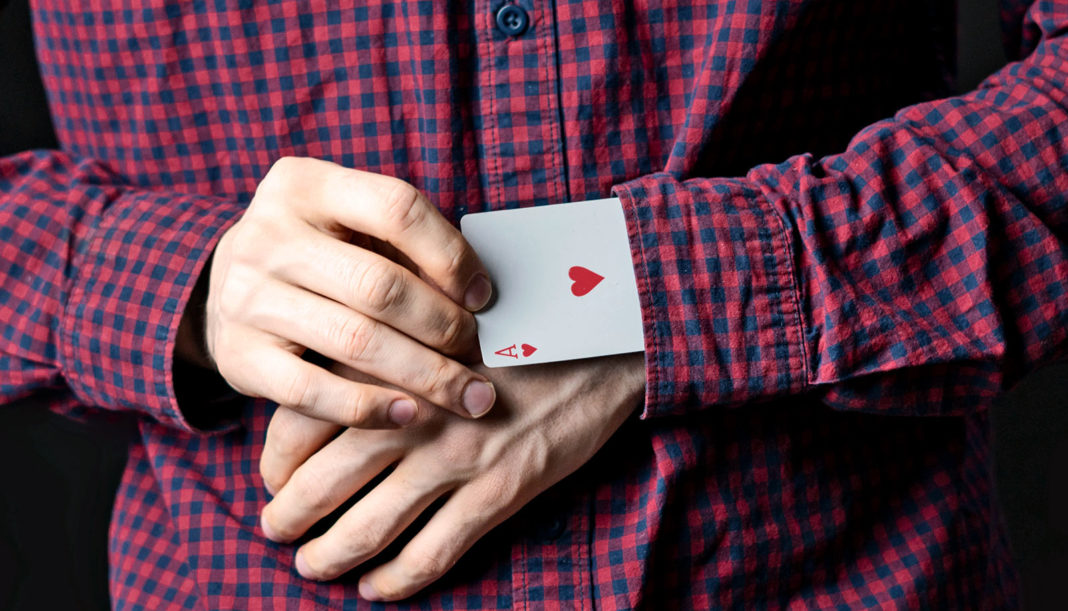 Man with card up sleeve