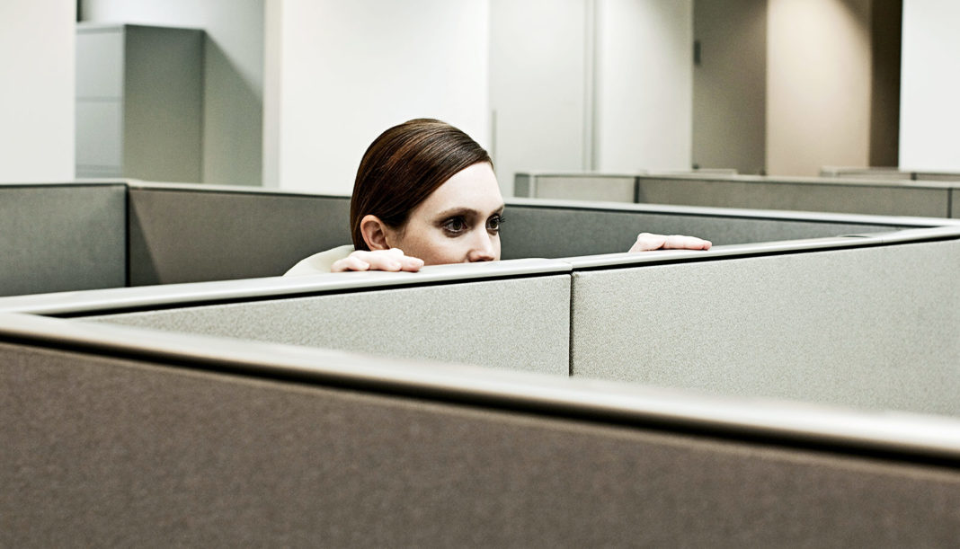 Woman in workplace cubicle