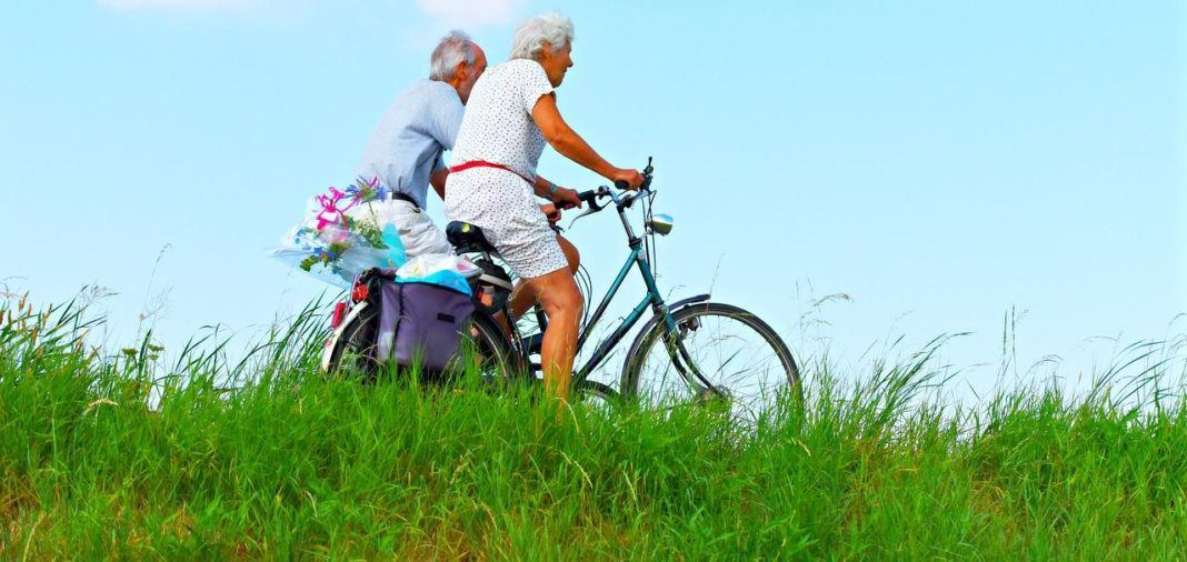 Aged couple on bike